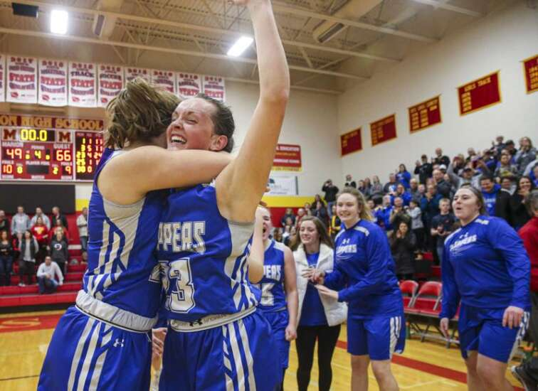 Clear Creek Amana shocks No. 2 Marion in girls' basketball regional finals