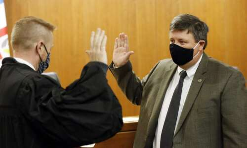 New Linn County Supervisor Louie Zumbach takes oath of office