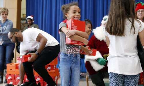 Photos: Garfield School students get new Nikes from Santa (and…