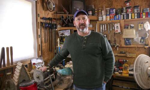 Building for birds: Reclaimed barn wood keeping math teacher busy