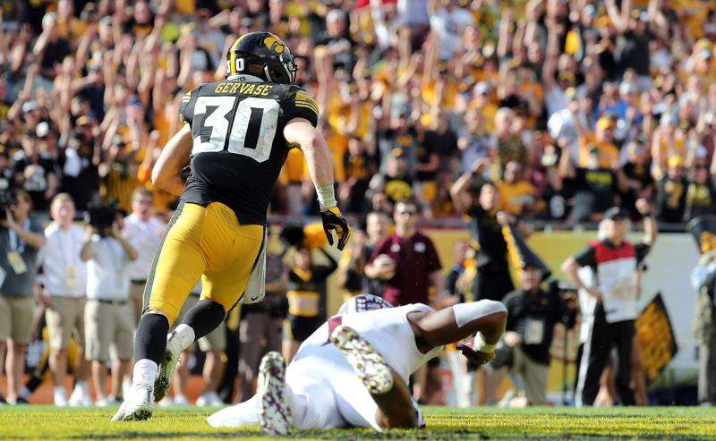 Ex Iowa football walk-ons walk off in glory at Outback Bowl