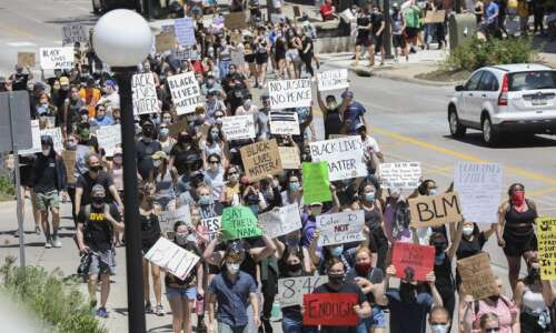 Photos: Protesters march through Iowa City in support of Black…