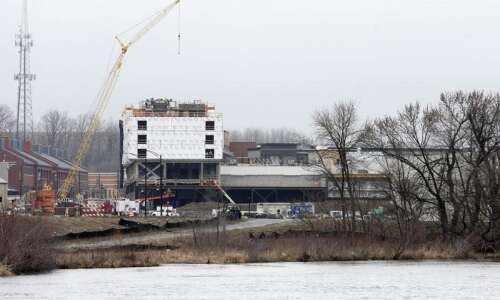 Work in progress at Iowa River Landing and along Coralville's…