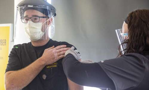 University of Iowa administers state's first COVID-19 vaccine