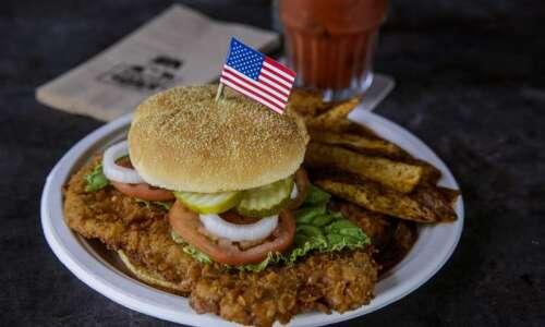 "New Cedar Rapids restaurant Foxhole ""Charlie"" Bar & Grill honors…"