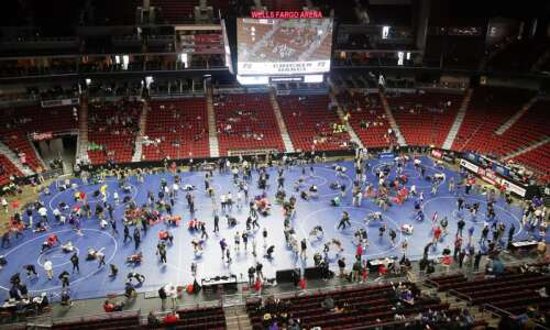 Iowa high school state wrestling notes: Limited attendance doesn't change…