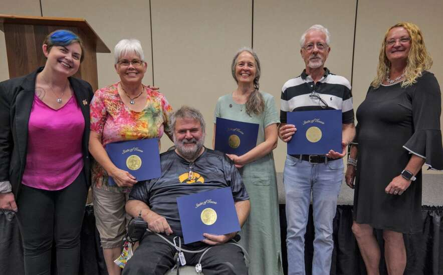 Four residents honored for volunteering at arts center