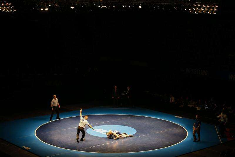 'It was gut-wrenching': The scene in Cedar Rapids as D-III Wrestling Championships were canceled