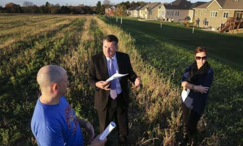 Cedar Rapids neighbors form company, buy land, take development into…