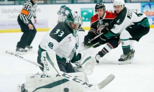 Cedar Rapids RoughRiders goaltender Jiri Patera bottles up Waterloo in…