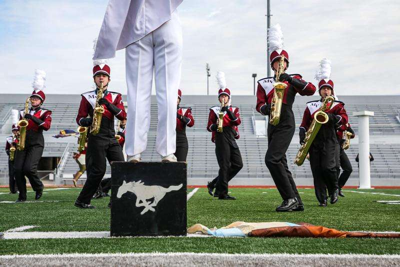 Photos from IHSMA's Marching Band Festival at Kingston Stadium in Cedar Rapids