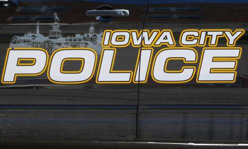 IC police: Man with gunshots found in crashed car, dies