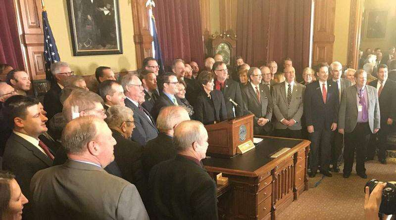 Gov. Reynolds signs Iowa water quality funding bill, her first bill signing