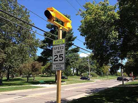 New school zone signals funded by traffic cameras