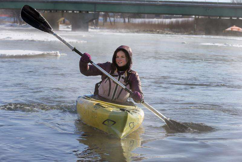 Iowa kayakers brave big freeze for New Year's Day river time