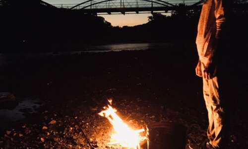 Searching for catfish by firelight