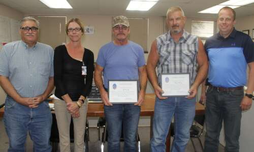 County honors longtime employees