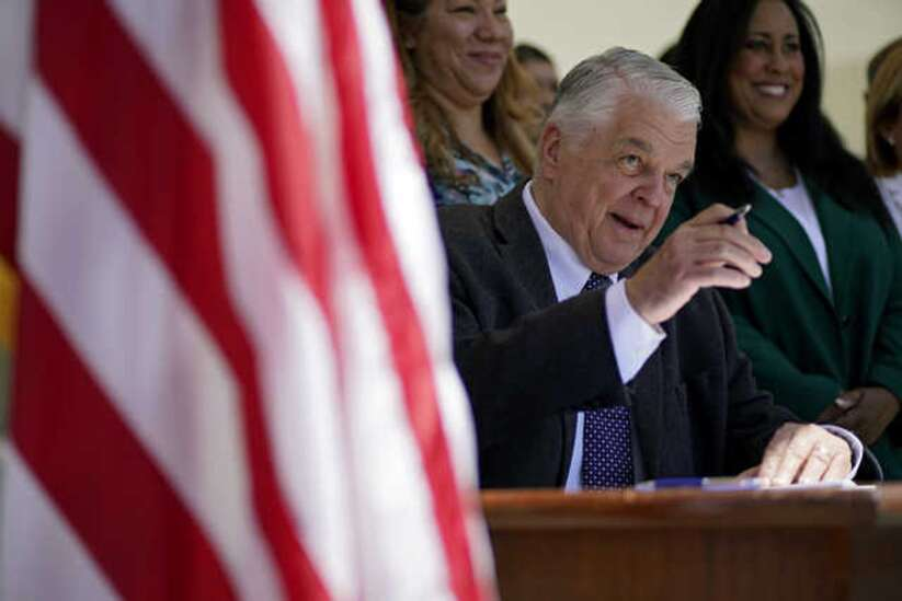 Governor signs law giving Nevada first presidential primary