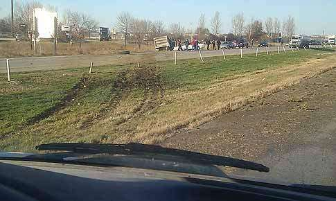 Dump truck runs through cable barriers on I-380