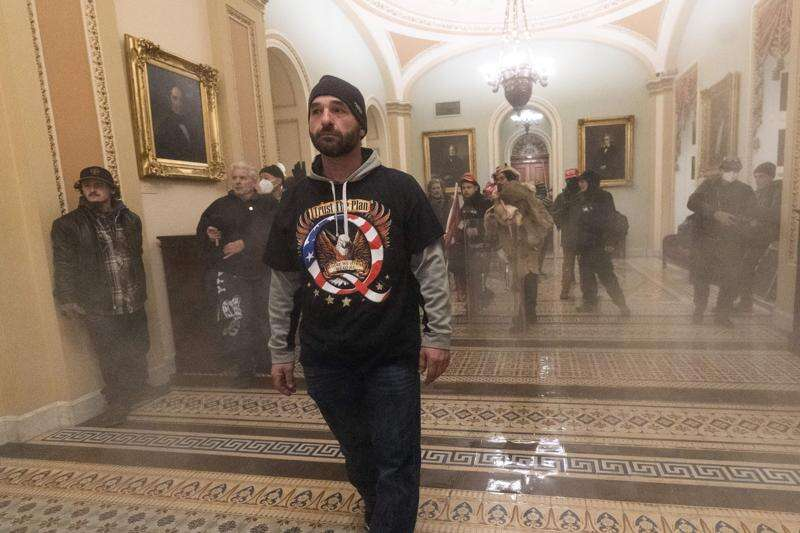 QAnon backer from Iowa was among first to breach Capitol