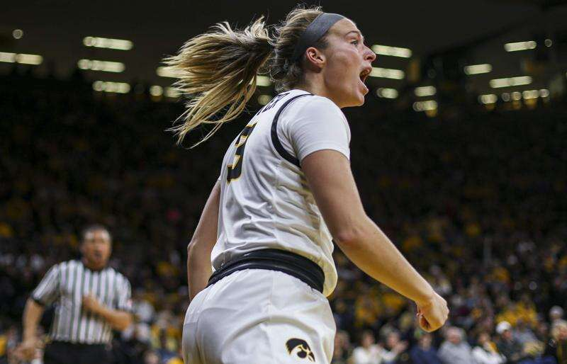 Iowa topples No. 12 Indiana in double-overtime, moves into a first-place tie in the Big Ten