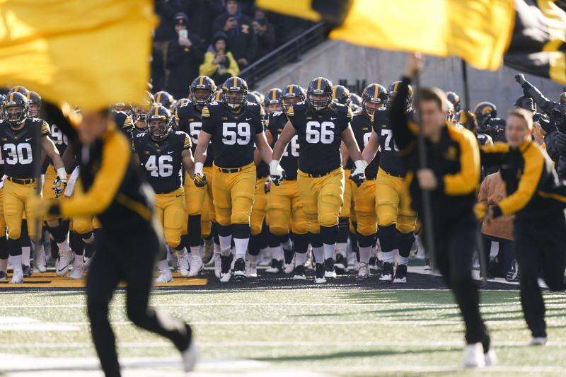 Declines in UI football, basketball revenue offset by Big Ten income
