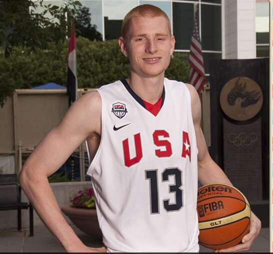 Aaron White is running with good basketball crowd