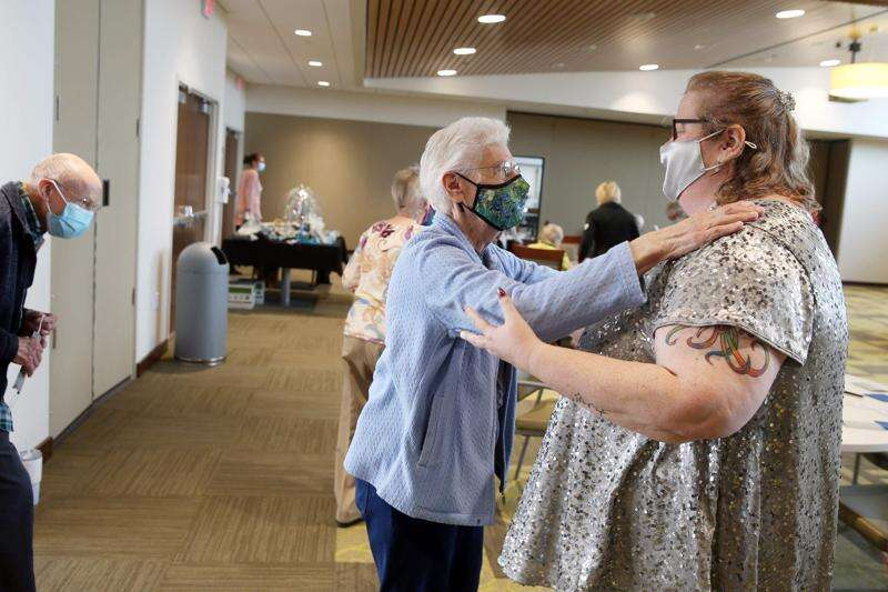 After year of fighting COVID-19, nursing homes see hope in relaxed visitation rules