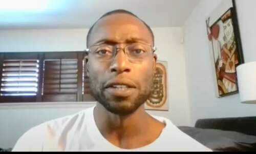 Former Iowa football player's home raided by FBI