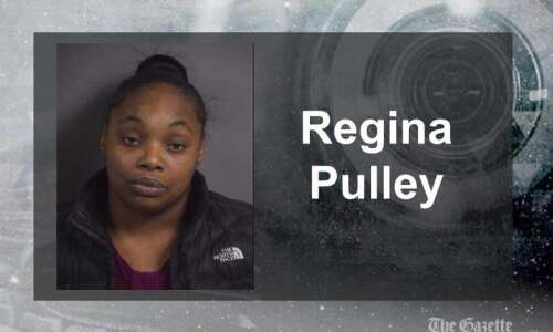 Iowa City woman accused of beating child with wooden object