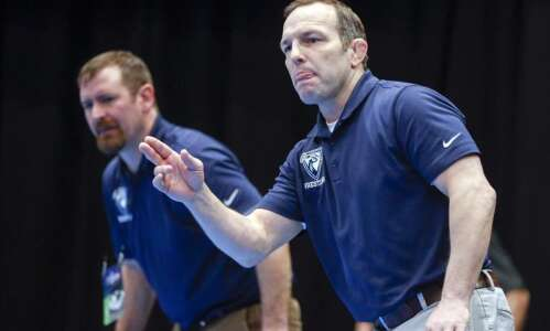 Upper Iowa wrestling coach Heath Grimm excited about Peacocks' potential