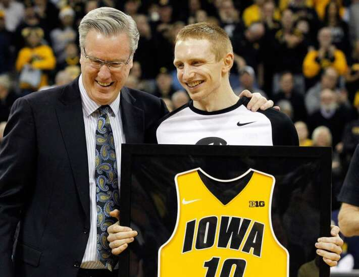 Former Hawkeye Mike Gesell takes in Urbana 5 Memorial while home from Europe