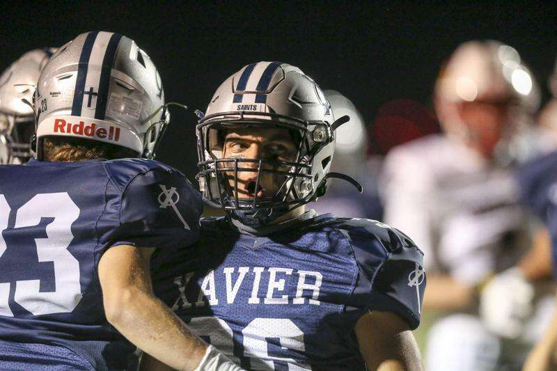 Xavier seniors devote passion — and time — to 4 sports