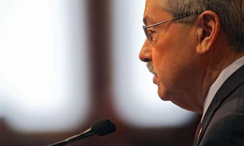 Branstad signs gambling cheating bill, 17 other measures
