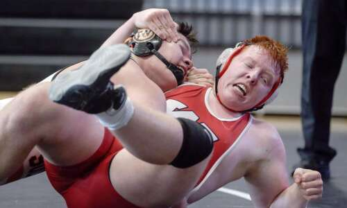 Solon's Tyler Linderbaum helps Spartans earn sectional team title
