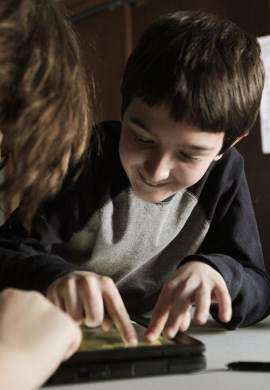 Touch-screen tablets help connect autistic kids with their families and world
