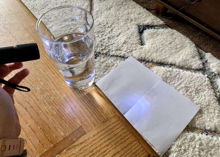 How to bend light by creating a prism with a glass of water