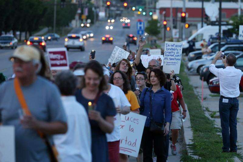 Protestors rally in Cedar Rapids against border detention