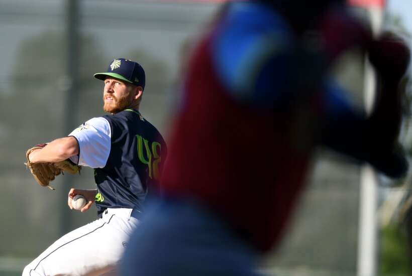 Cedar Rapids Kernels pitcher Jon Olsen gets a victory that was a long time coming