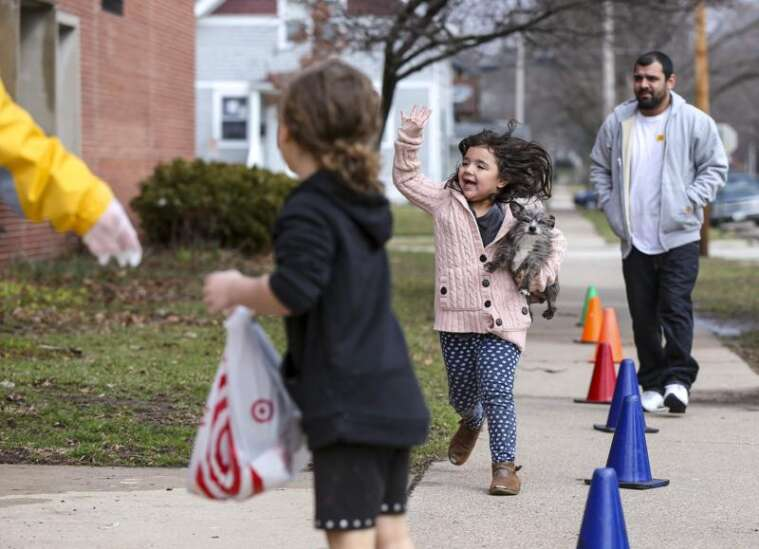 'We'll get through this:' school staff hand out free meals as three-week closure sets in