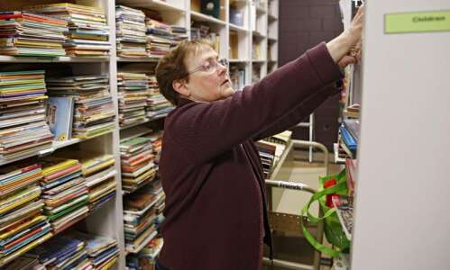 Cedar Rapids library volunteers help sort donated books