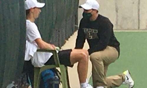 After a few delays, Iowa City West boys' tennis coach…