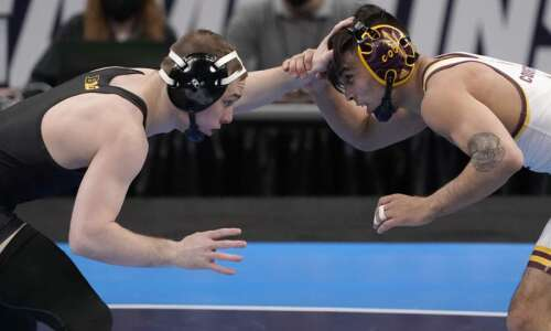 NCAA wrestling notes: Iowa's Spencer Lee grows legendary status with…