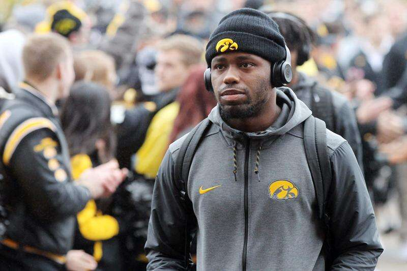 Attorneys for 8 former Iowa football players say they will file lawsuit against the school