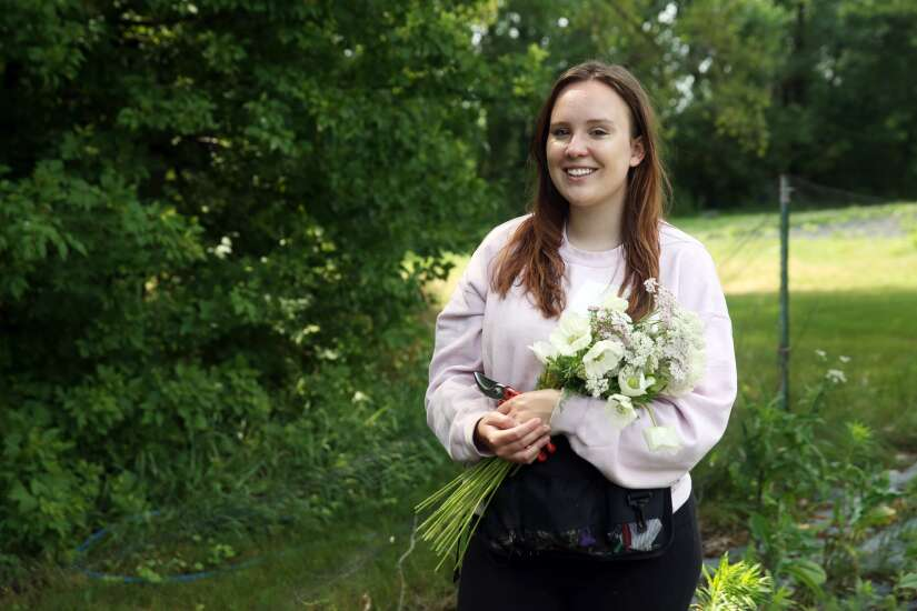 Beautifully Bloomed florist in Cedar Rapids planting seeds for next year's weddings