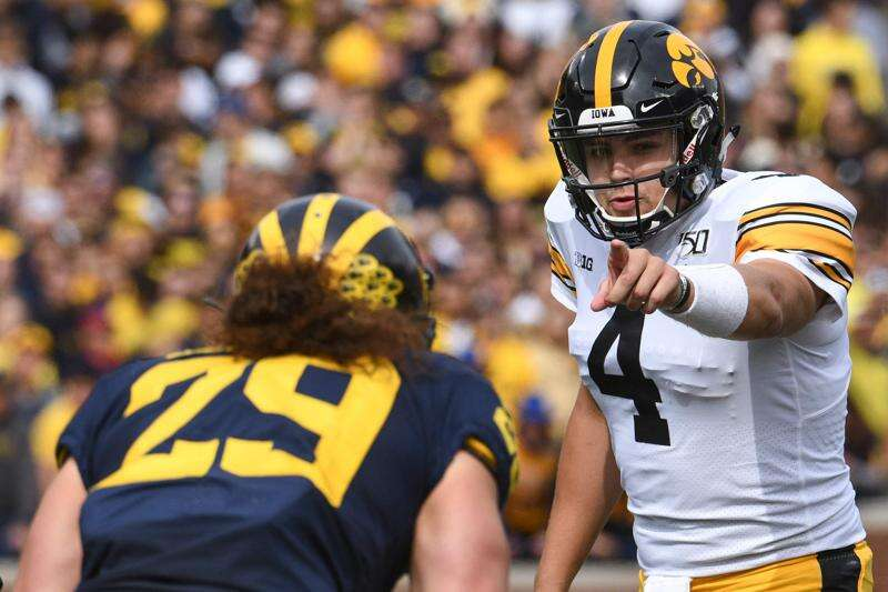 Iowa Hawkeyes had to help their QB up 8 times at Michigan and, yeah, that's frustrating