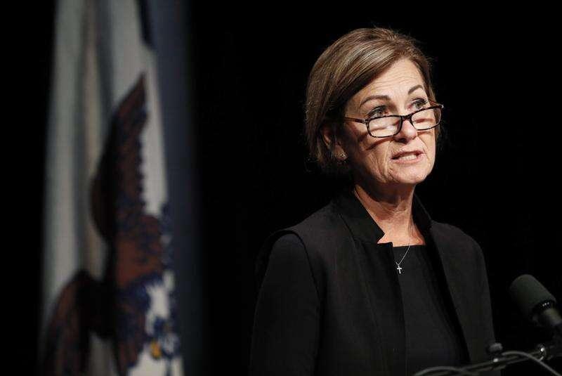 Gov. Kim Reynolds warns schools not to defy law