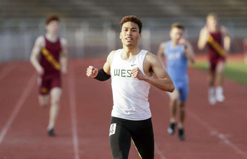 Iowa City West's Gabe Caruthers flies through a fast 100 and 400