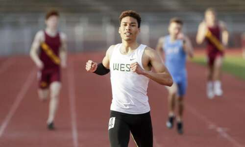 Iowa City West's Gabe Caruthers flies through a fast 100…