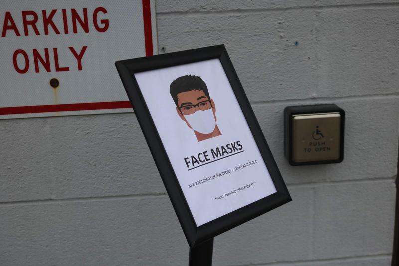 Signs requiring masks sprout around Mt. Pleasant Tuesday